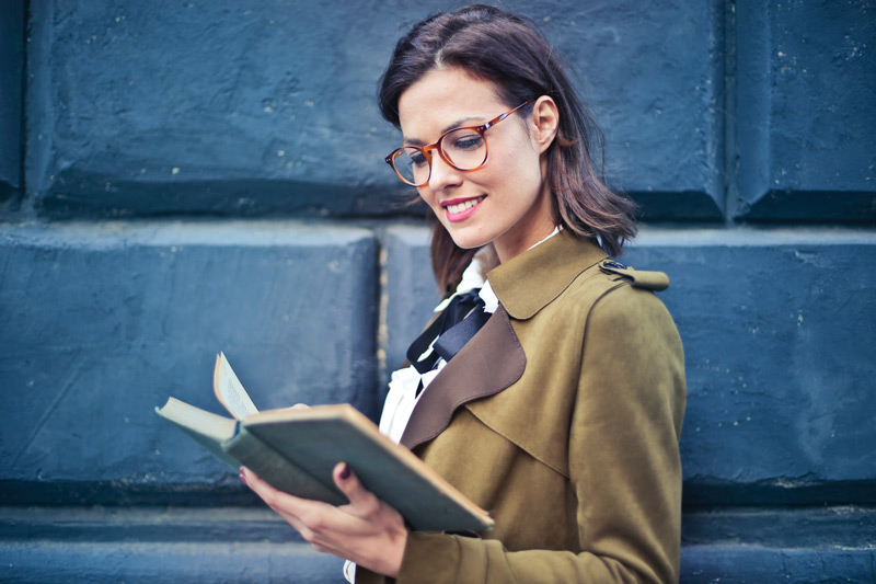 negative-space-woman-glasses-reading-book-bruce-mars